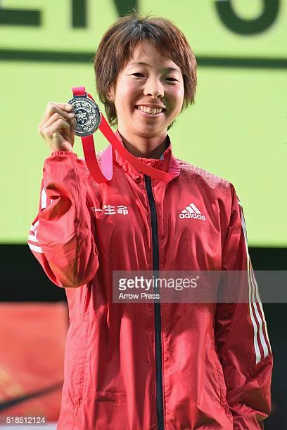 Satomi Tanaka of Japan celebrates after finishing second in the Nagoya Women's Marathon 2016 on March 13 2016 in Nagoya Japan
