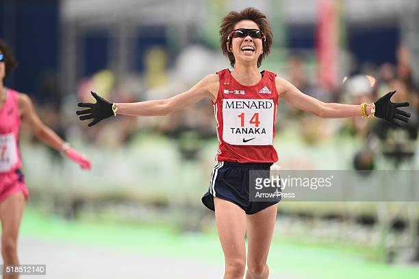 Satomi Tanaka of Japan crosses the finishing tape to come in the second place in the Nagoya Women's Marathon 2016 on March 13 2016 in Nagoya Japan