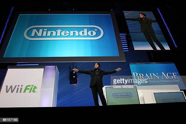 Satoru Iwata Nintendo Co Ltd global president presents the Nintendo DSi system at the Nintendo media briefing on opening day of the 2009 E3 Expo on...