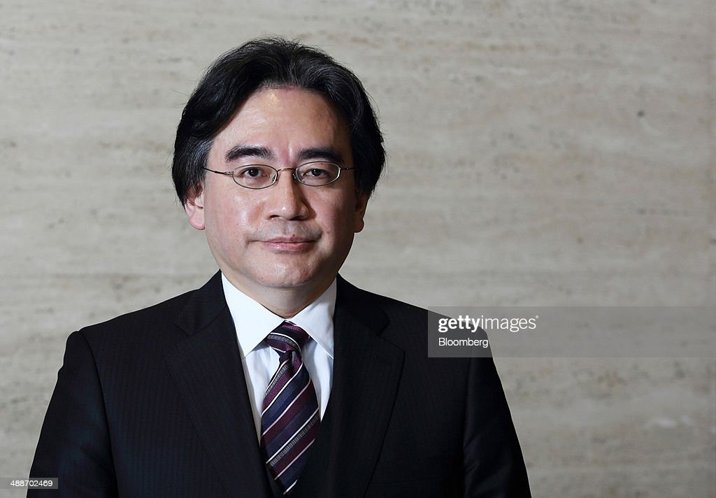 <a gi-track='captionPersonalityLinkClicked' href=/galleries/search?phrase=Satoru+Iwata+-+Businessman&family=editorial&specificpeople=815873 ng-click='$event.stopPropagation()'>Satoru Iwata</a>, president of Nintendo Co., poses for a photograph after an interview in Tokyo, Japan, on Thursday, May 8, 2014. Nintendo, the Japanese maker of video-game machines struggling to win over consumers with its latest generation of devices, plans to expand in emerging markets with new gaming devices starting next year. Photographer: Tomohiro Ohsumi/Bloomberg via Getty Images
