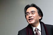 Satoru Iwata president of Nintendo Co speaks to reporters as he leaves a news conference in Osaka Japan on Wednesday Jan 28 2015 Iwata who led the...