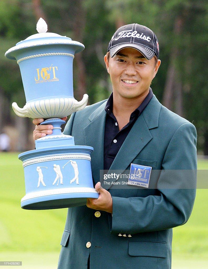 Satoshi Kodaira poses for photographs after winning the Japan Golf Tour Championship Shishido Hills at Shishido Hills Country Club on June 23, 2013 in Kasama, Ibaraki, Japan.