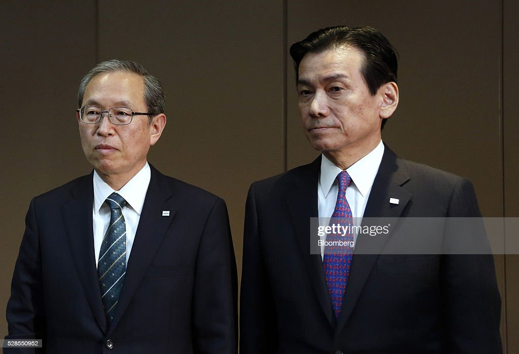 Satoshi Tsunakawa, incoming president of Toshiba Corp., left, and Shigenori Shiga, incoming chairman of Toshiba Corp., pose for photographs during a news conference in Tokyo, Japan, on Friday, May 6, 2016. Toshiba named Tsunakawa to be its next president as the troubled electronics conglomerate promotes from within after an accounting scandal. Photographer: Tomohiro Ohsumi/Bloomberg via Getty Images