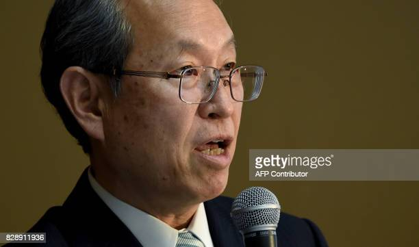 Satoshi Tsunakawa president of Toshiba answers questions during a press conference at the company's headquarters in Tokyo on August 10 2017 Toshiba...