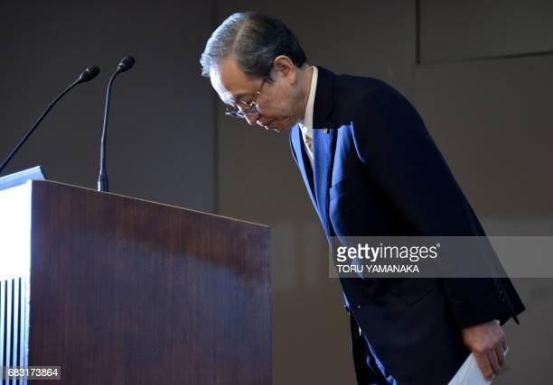 Satoshi Tsunakawa president of Toshiba bows during a press conference at the headquarters in Tokyo on May 15 2017 Troubled conglomerate Toshiba on...