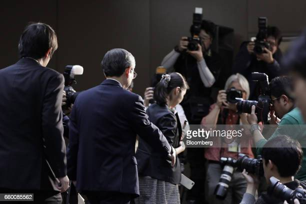Satoshi Tsunakawa president of Toshiba Corp exits past photographers following a news conference in Tokyo Japan on Wednesday March 29 2017 Toshiba...