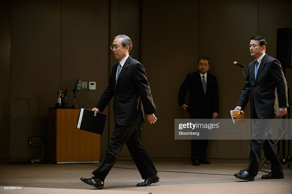 Satoshi Tsunakawa, president of Toshiba Corp., left, arrives at a news conference in Tokyo, Japan, on Friday, Jan. 27, 2017. Toshiba, facing a multibillion-dollar writedown in its nuclear power division, is reconsidering plans to accept new reactor orders. Photographer: Akio Kon/Bloomberg via Getty Images