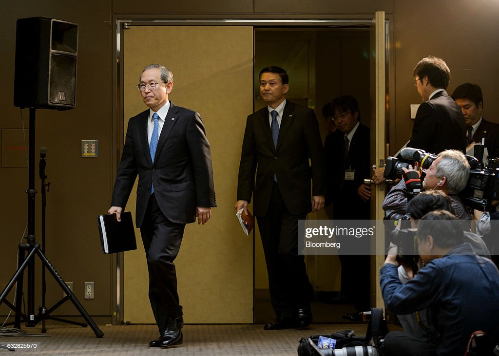 Satoshi Tsunakawa, president of Toshiba Corp., left, arrives for a news conference in Tokyo, Japan, on Friday, Jan. 27, 2017. Toshiba, facing a multibillion-dollar writedown in its nuclear power division, is reconsidering plans to accept new reactor orders. Photographer: Akio Kon/Bloomberg via Getty Images