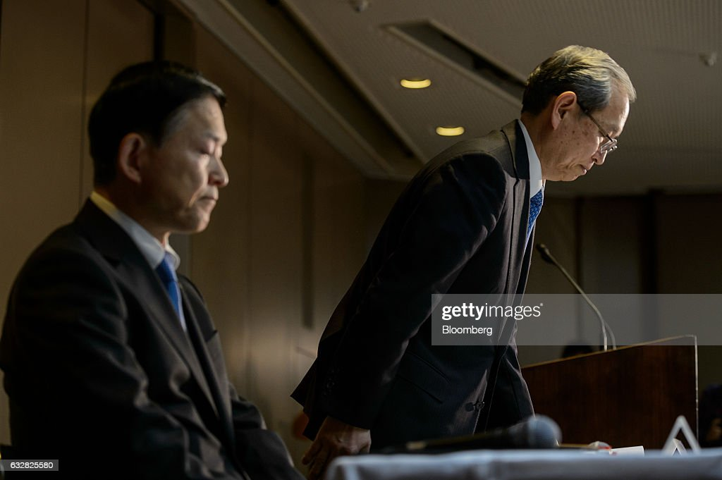 Satoshi Tsunakawa, president of Toshiba Corp., right, bows as Yasuo Naruke, corporate senior executive vice president at Toshiba Corp., pauses during a news conference in Tokyo, Japan, on Friday, Jan. 27, 2017. Toshiba, facing a multibillion-dollar writedown in its nuclear power division, is reconsidering plans to accept new reactor orders. Photographer: Akio Kon/Bloomberg via Getty Images