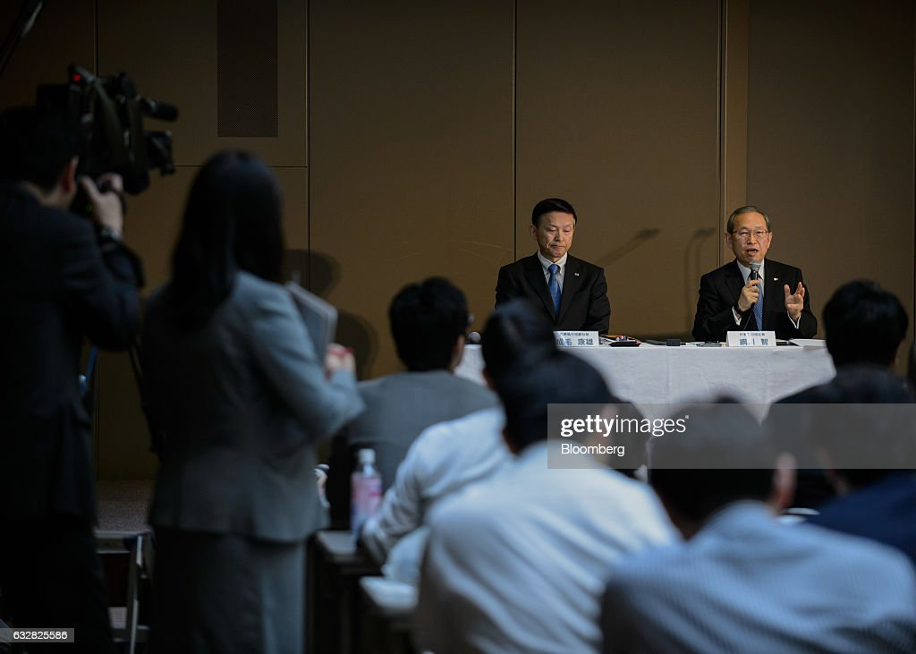 Satoshi Tsunakawa, president of Toshiba Corp., right, speaks as Yasuo Naruke, corporate senior executive vice president at Toshiba Corp., listens during a news conference in Tokyo, Japan, on Friday, Jan. 27, 2017. Toshiba, facing a multibillion-dollar writedown in its nuclear power division, is reconsidering plans to accept new reactor orders. Photographer: Akio Kon/Bloomberg via Getty Images
