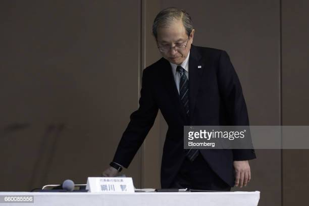 Satoshi Tsunakawa president of Toshiba Corp takes his seat before a news conference in Tokyo Japan on Wednesday March 29 2017 Toshiba projected its...