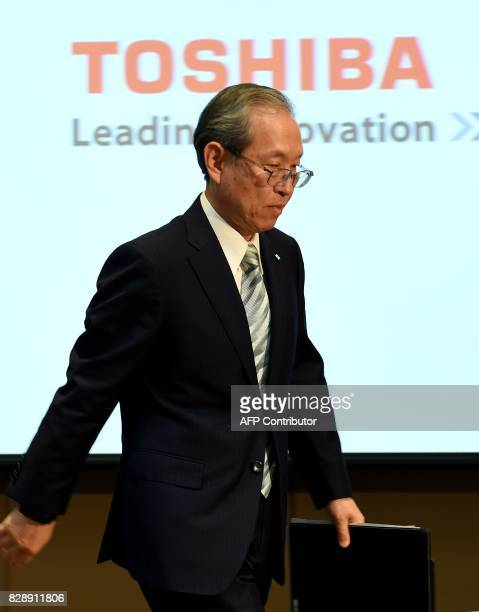 Satoshi Tsunakawa president of Toshiba leaves the room after a press conference at the company's headquarters in Tokyo on August 10 2017 Toshiba on...