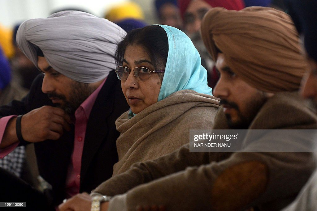 Satpal Kaleka, (C) the wife of the late Satwant Singh Kaleka who was killed by a gunman at a Sikh Shrine in Wisconsin in the United States, and her sons Pardeep Singh (L) and Amardeep Singh (R) listen to kirtan -eulogy - for the Sikhs killed in Wisconsin, at the Sikh Shrine Golden temple complex in Amritsar on January 8, 2013. A gunman on August 5 ,2012 shot worshippers at a suburban Sikh temple in Wisconsin in the mid-western United States, killing at least six people before he was shot dead by police.