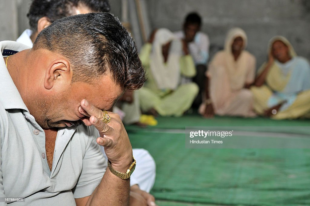 Satpal Singh childhood friend of Indian prisoner in Pakistan Sarabjit Singh mourning his death at Sarabjit's native house in village Bikhiwind on May 2, 2013 about 40 KMS from Amritsar, India. Sarabjit Singh, died early today after being comatose for almost a week following an attack by other prisoners at a Lahore jail.