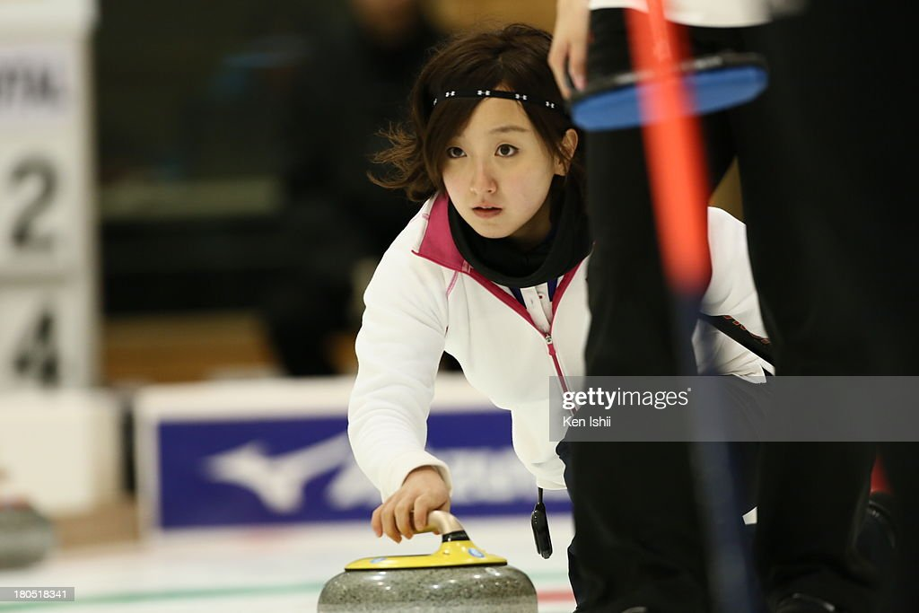 Satsuki Fujisawa of Chubu Electric Power Co. throws a stone during the last day of qualifier for the Curling Japan Qualifying Tournament at Dohgin Curling Stadium on September 14, 2013 in Sapporo, Japan.