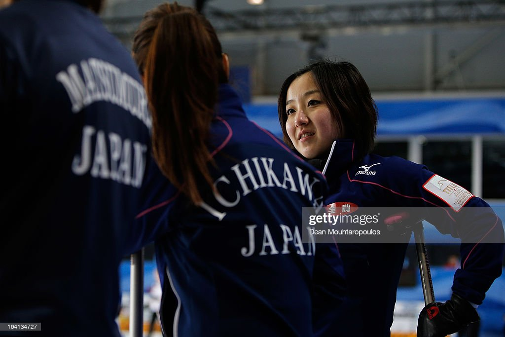 Satsuki Fujisawa (R) of Japan speaks to team mates in the match between Japan and Russia on Day 5 of the Titlis Glacier Mountain World Women's Curling Championship at the Volvo Sports Centre on March 20, 2013 in Riga, Latvia.