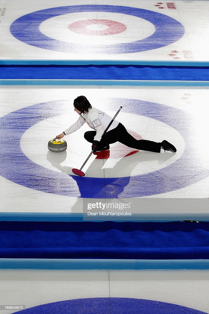 <a gi-track='captionPersonalityLinkClicked' href=/galleries/search?phrase=Satsuki+Fujisawa&family=editorial&specificpeople=10009829 ng-click='$event.stopPropagation()'>Satsuki Fujisawa</a> of Japan throws the stone in the match between Japan and Germany during Day 3 of the Titlis Glacier Mountain World Women's Curling Championship at the Volvo Sports Centre on March 18, 2013 in Riga, Latvia.