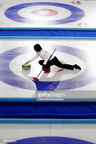 Satsuki Fujisawa of Japan throws the stone in the match between Japan and Germany during Day 3 of the Titlis Glacier Mountain World Women's Curling...
