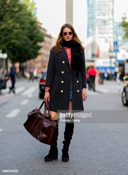 Satu Jasmin Jalo wearing a black scarf mini skirt overknees weekender bag during the second day of the Stockholm Fashion Week Spring/Summer 2017 on...