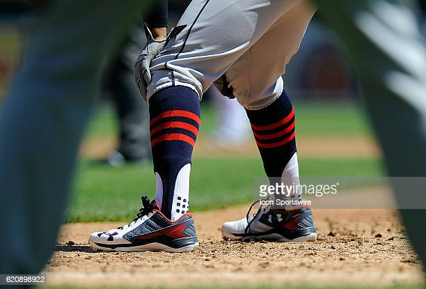The striped stirrup socks of Cleveland Indians Shortstop Francisco Lindor [9119] as he leads off first base during the Indians' game against the...