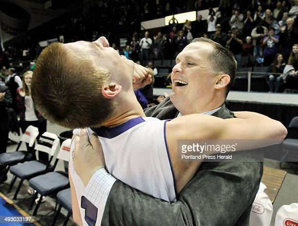 Saturday February 25 2012 Deering vs Bonny Eagle boys class A regional championship game Deering coach Dan LeGage hugs player Patrick Green whose...