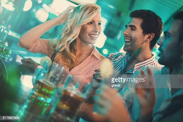 Saturday night fun in a bar.