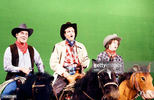Saturday Night Live Episode 20 Pictured Phil Hartman as cowboy Woody Harrelson as cowboy Dana Carvey as cowboy during the 'Cowboy Song' musical...