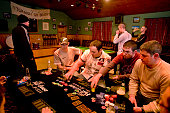 Saturday night on Tory Island Playing poker in the social club Nine miles off the Donegal coast NorthWest Ireland This remote island two and a half...
