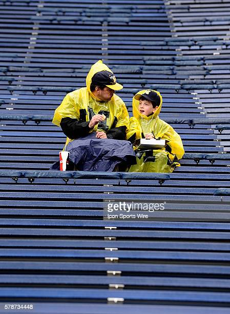 Rain didn't dampen the fun for this father and son who arrived early and enjoyed some pizza together before Michigan's clash with Indiana Saturday...