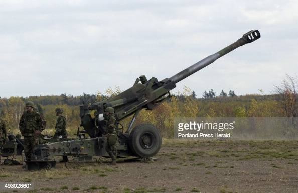 Saturday October 20 2001 Maine Army National Guardsmen load a round into a Howitzer gun on Saturday during training at the Canadian Forces Base...