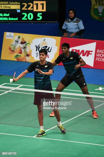 Satwiksairaj Rankireddy and Chirag Shetty of India compete against Altof Barriq and Reinard Dhanriano of Indonesia during their qualification round...