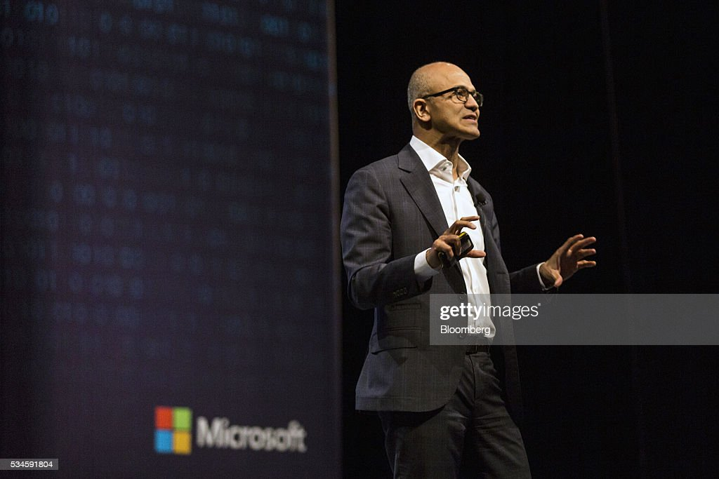 <a gi-track='captionPersonalityLinkClicked' href=/galleries/search?phrase=Satya+Nadella&family=editorial&specificpeople=7402445 ng-click='$event.stopPropagation()'>Satya Nadella</a>, chief executive officer of Microsoft Corp., speaks during the opening keynote session at the Microsoft Developer Day in Singapore, on Friday, May 27, 2016. Microsoft has all but abandoned the smartphone game. The company said Wednesday that it will axe as many as 1,850 jobs, many of them in Finland -- home base of the handset business Microsoft acquired two years ago from Nokia Oyj. Photographer: Charles Pertwee/Bloomberg via Getty Images