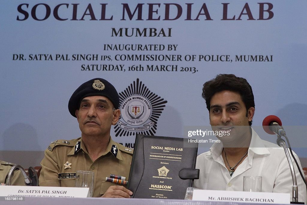 Satyapal Singh, Commissioner of Police, Mumbai along with Abhishek Bachchan , Bollywood Actor at the launch of Social Media Lab at CST on March 16, 2013 in Mumbai, India. The lab is aimed at gathering all the available information on the web on the issues pertaining to governance and public order, based on which, police will chalk out a strategy to maintain law and order.