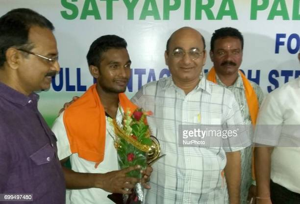 Satyapir Pradhan of a tribal dominated district Bhawanipatna gives photo pose after getting record into the prestigious Guinness Book of Records in...
