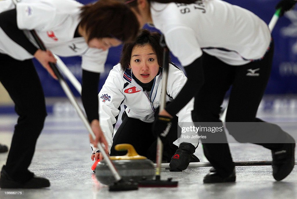 Satzuki Fujisawa of Japan watches her stone during the Pacific Asia 2012 Curling Championship at the Naseby Indoor Curling Arena on November 24, 2012 in Naseby, New Zealand.