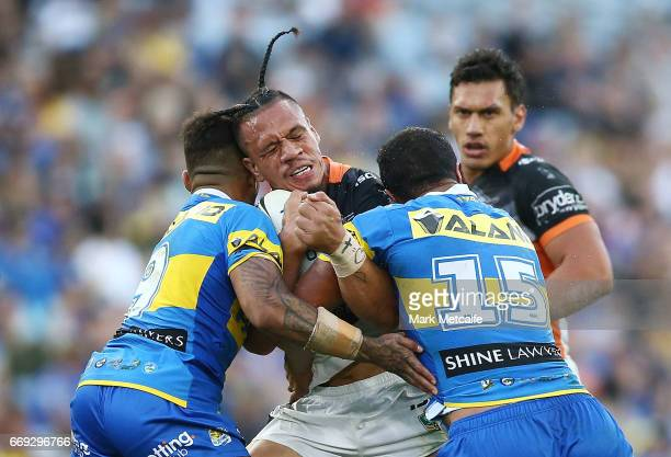 Sauaso Sue of the Tigers is tackled during the round seven NRL match between the Parramatta Eels and the Wests Tigers at ANZ Stadium on April 17 2017...