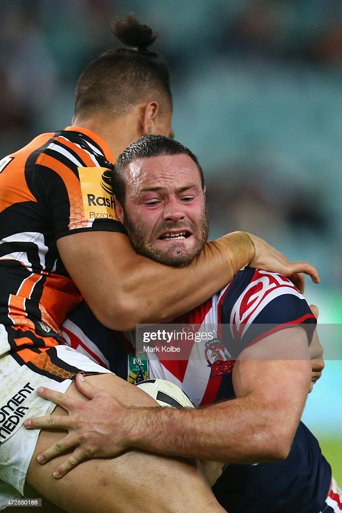 Sauaso Sue of the Wests Tigers tackles Boyd Cordner of the Roosters during the round nine NRL match between the Sydney Roosters and the Wests Tigers at Allianz Stadium on May 8, 2015 in Sydney, Australia.