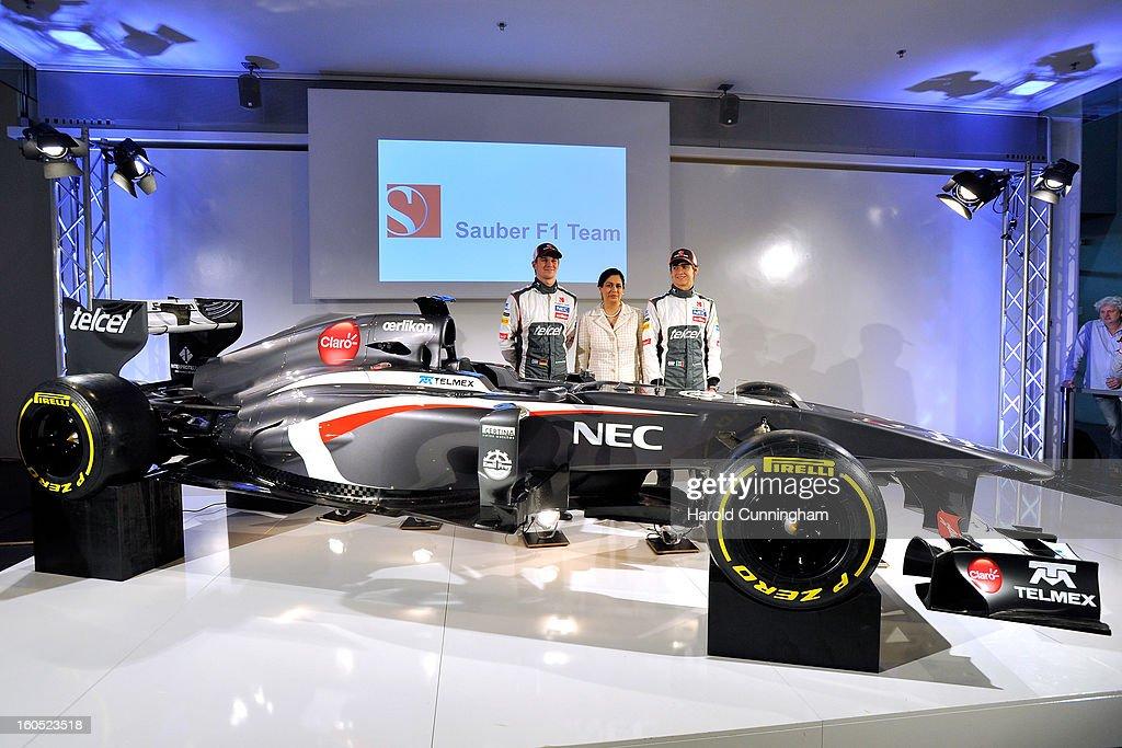 Sauber F1 driver Nico Hulkenberg of Germany, Sauber Team Principal Monisha Kaltenborn, and Sauber F1 driver Esteban Gutierrez of Mexico unveil the Sauber C32-Ferrari new car for the 2013 Formula 1 season, during the launch at the Sauber Motorsport AG on February 2, 2013 in Hinwil, Switzerland.