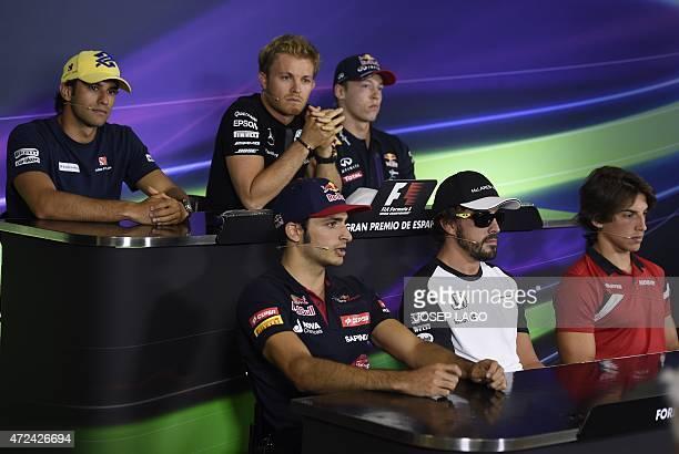 Sauber F1 Team's Brazilian driver Felipe Nasr Scuderia Toro Rosso's Spanish driver Carlos Sainz Jr Mercedes AMG Petronas F1 Team's German driver Nico...