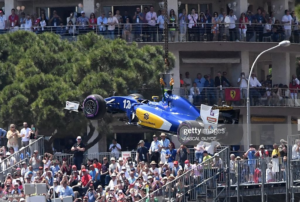 Sauber F1 Team's Brazilian driver Felipe Nasr's car is evacuated after he broke is engine during the qualifying session at the at the Monaco street circuit, on May 28, 2016 in Monaco, one day ahead of the Monaco Formula 1 Grand Prix. / AFP / PASCAL