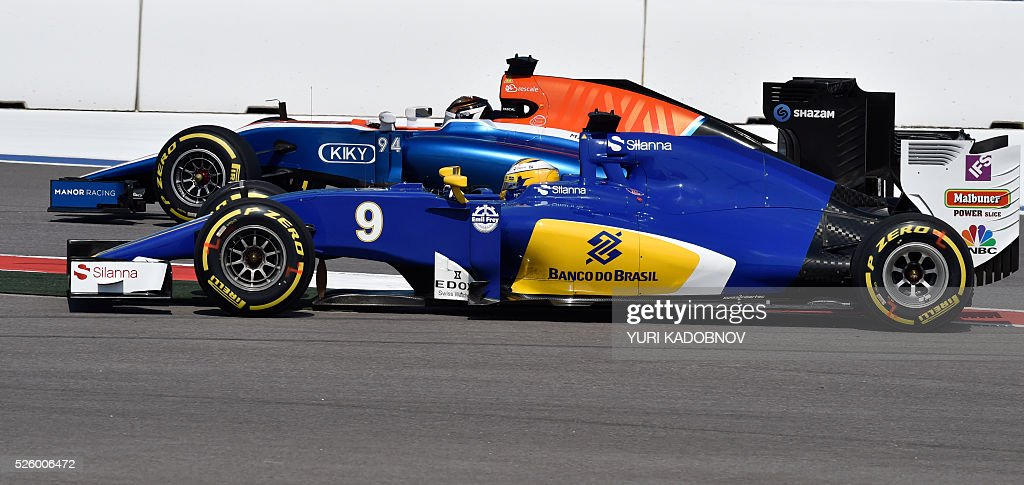 Sauber F1 Team's Swedish driver Marcus Ericsson (front) and Manor Racing MRT's German driver Pascal Wehrlein steer their cars during the second practice session of the Formula One Russian Grand Prix at the Sochi Autodrom circuit on April 29, 2016. / AFP / YURI