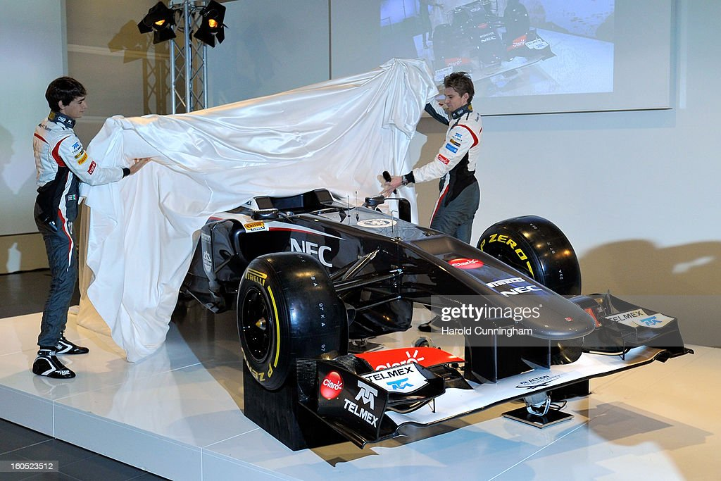 Sauber Formula 1 drivers Esteban Gutierrez of Mexico and <a gi-track='captionPersonalityLinkClicked' href=/galleries/search?phrase=Nico+Hulkenberg&family=editorial&specificpeople=2566799 ng-click='$event.stopPropagation()'>Nico Hulkenberg</a> of Germany unveil the Sauber C32-Ferrari new car for the 2013 Formula 1 season, during the launch at the Sauber Motorsport AG on February 2, 2013 in Hinwil, Switzerland.