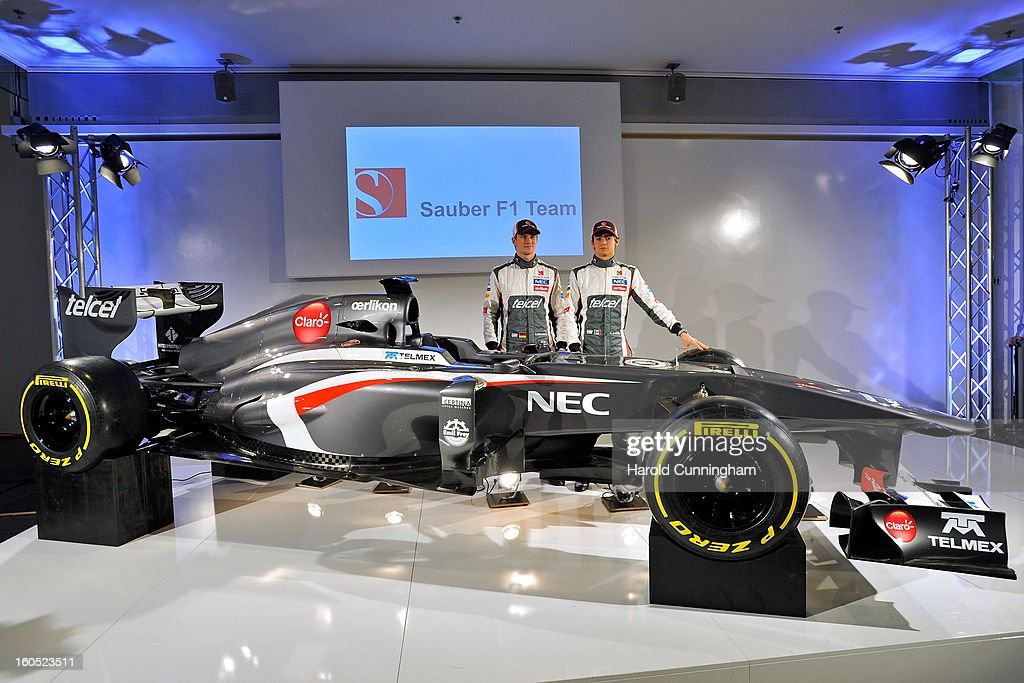 Sauber Formula 1 drivers <a gi-track='captionPersonalityLinkClicked' href=/galleries/search?phrase=Nico+Hulkenberg&family=editorial&specificpeople=2566799 ng-click='$event.stopPropagation()'>Nico Hulkenberg</a> of Germany and Esteban Gutierrez of Mexico unveil the Sauber C32-Ferrari new car for the 2013 Formula 1 season, during the launch at the Sauber Motorsport AG on February 2, 2013 in Hinwil, Switzerland.