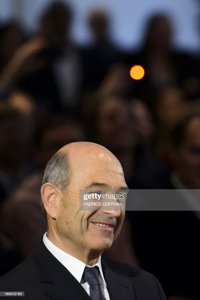 Sauber formula One team founder Peter Sauber smiles during the unveil event of the new Sauber C32-Ferrari car for 2013 Formula One season on February 2, 2013 in Hinwil, Switzerland. AFP PHOTO / FABRICE COFFRINI