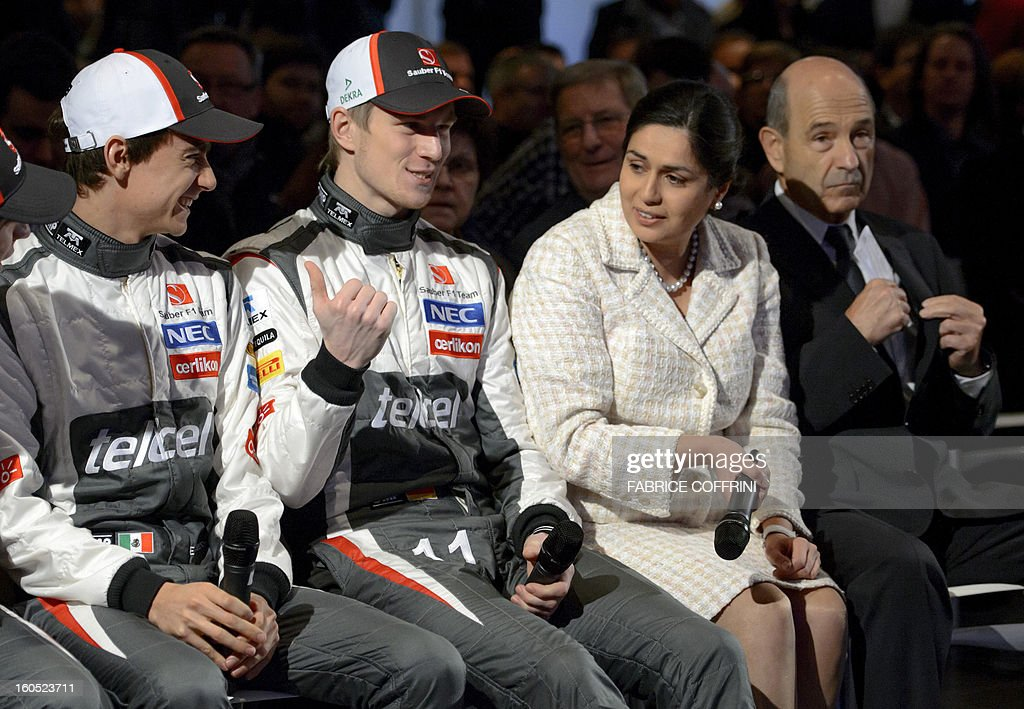 Sauber forumula One team drivers Esteban Gutierrez from Mexico and Nico Hulkenberg from Germany, flanked by Sauber Team Principal Monisha Kaltenborn and Sauber Founder Peter Sauber, attend the unveil event of their Sauber C32-Ferrari car for 2013 Formula One season on February 2, 2013 in Hinwil, Switzerland.