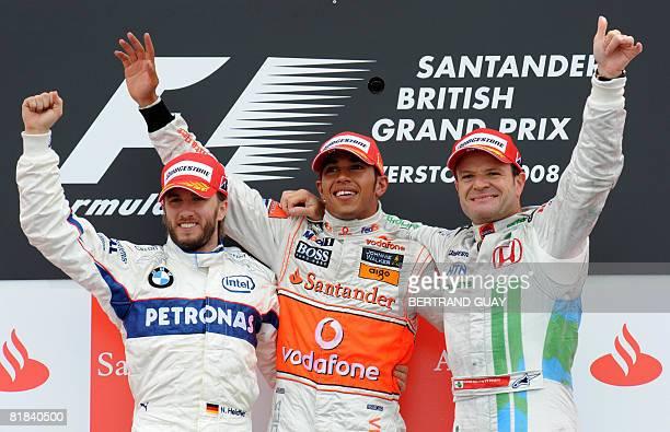 BMW Sauber's German driver Nick Heidfeld McLaren Mercedes' British driver Lewis Hamilton and Honda's Brazilian driver Rubens Barrichello celebrate on...