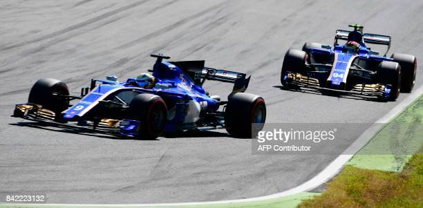 Sauber's German driver Pascal Wehrlein drives behind team mate Sauber's Swedish driver Marcus Ericsson during the Italian Formula One Grand Prix at...
