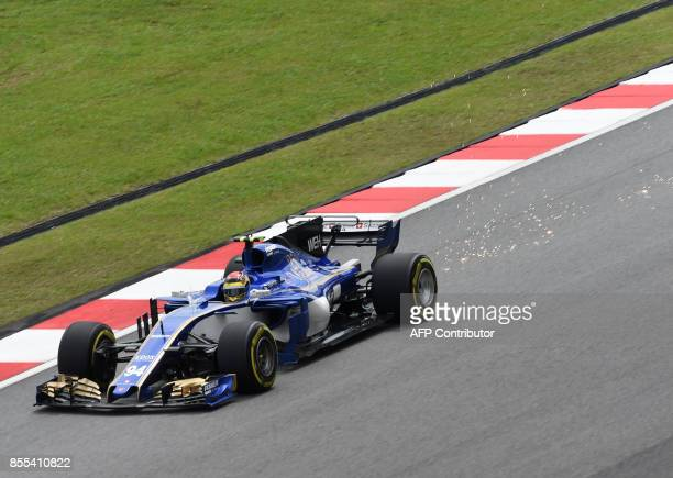 Sauber's German driver Pascal Wehrlein drives during his second practice session of the Formula One Malaysia Grand Prix at the Sepang circuit near...