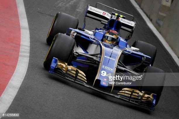 Sauber's German driver Pascal Wehrlein drives during the first practice session at the Silverstone motor racing circuit in Silverstone central...