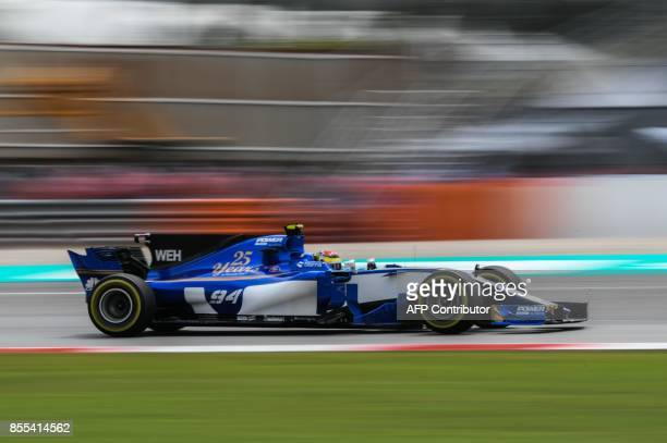 Sauber's German driver Pascal Wehrlein drives during the second practice session of the Formula One Malaysia Grand Prix in Sepang on September 29...